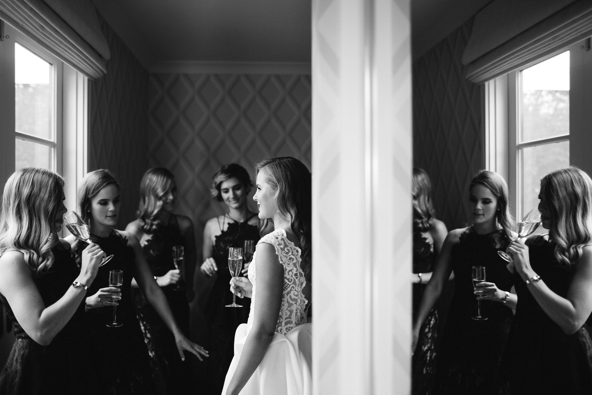 bride and bridesmaids prep with champagne