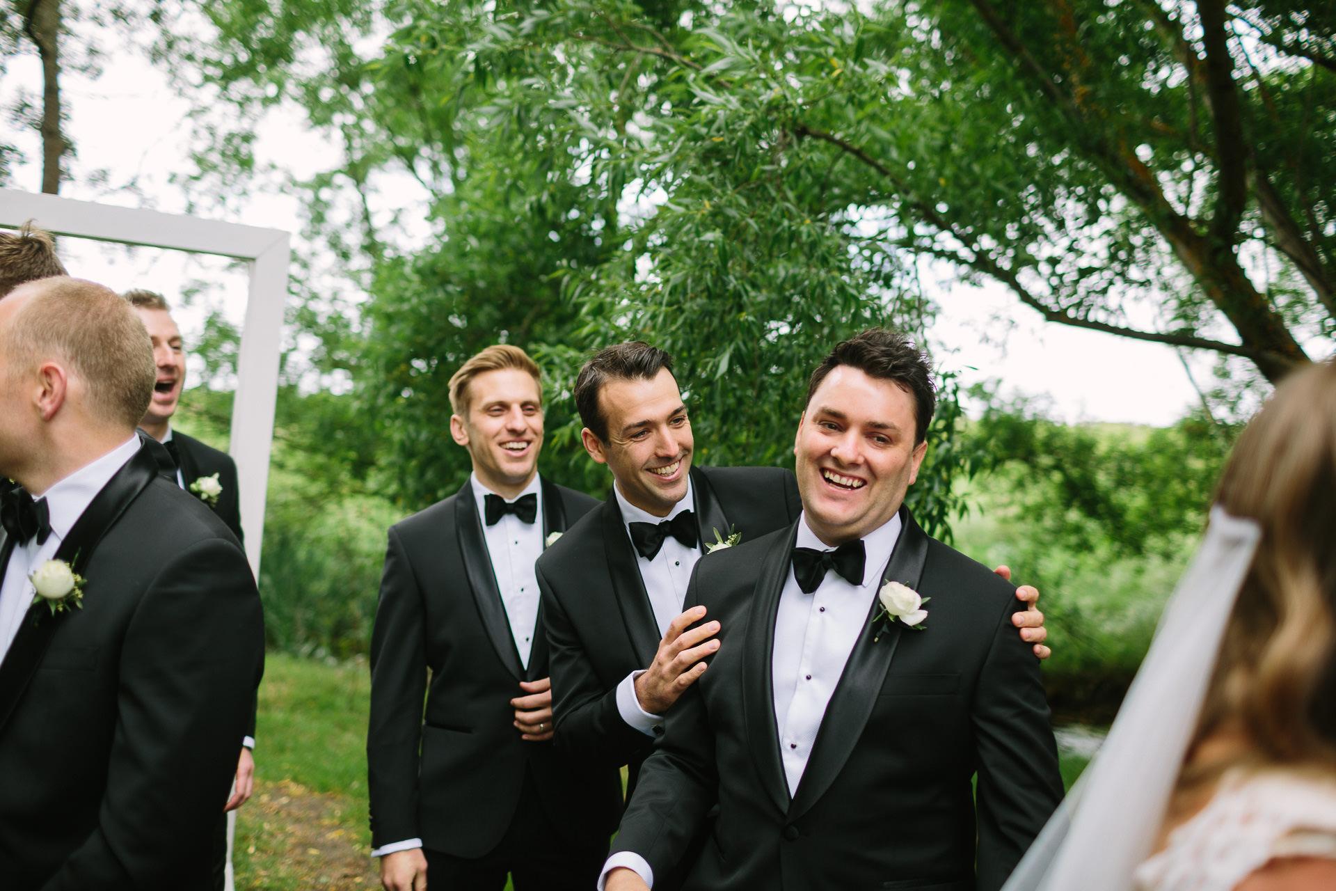 Happy groom celebrates with mates