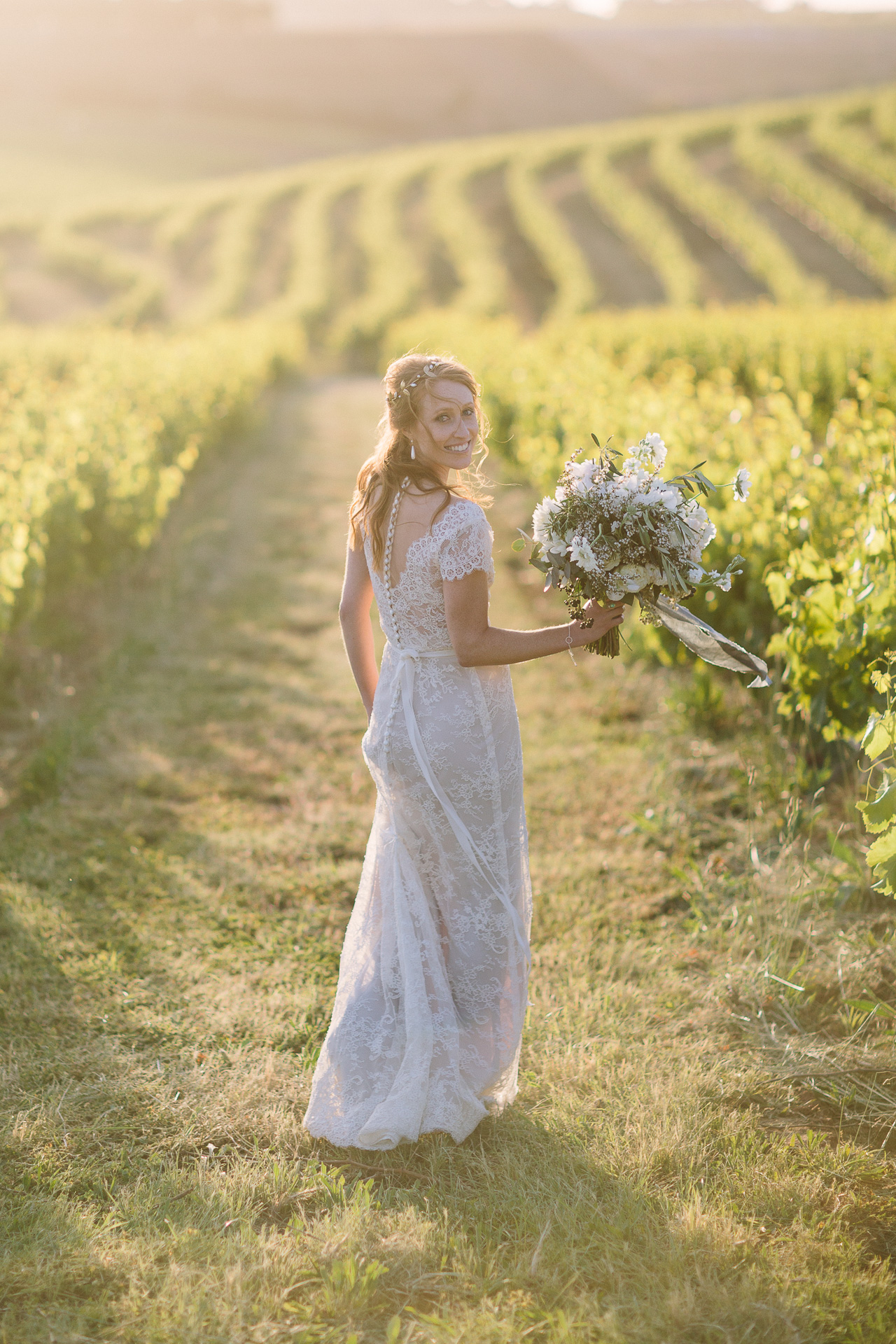 bride in gorgeous light in Coriole winery vineyard mclarenvale