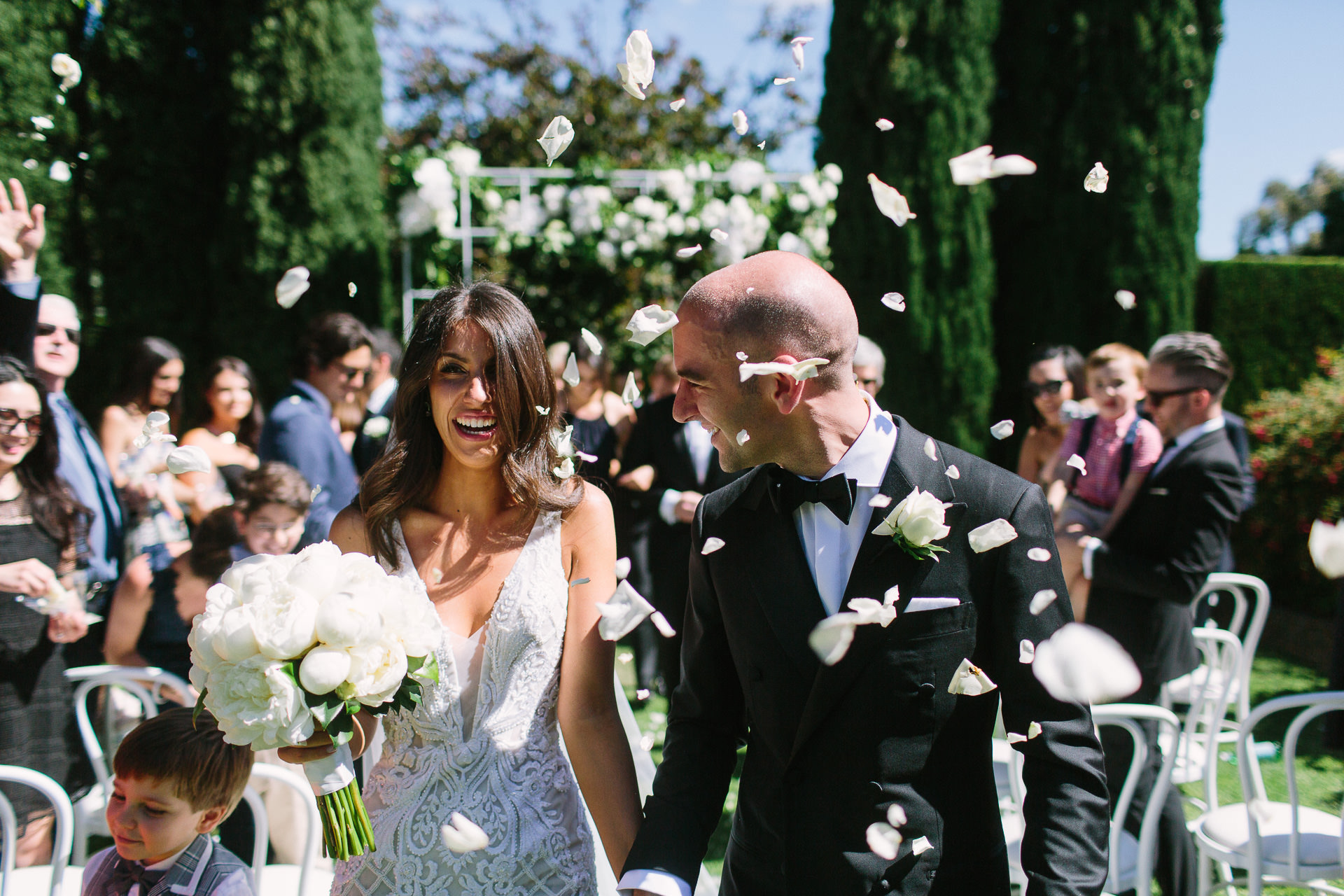 Bride and Groom and flower petals, Just married in Garden Ceremony at Mandalay House, Adelaide Hills