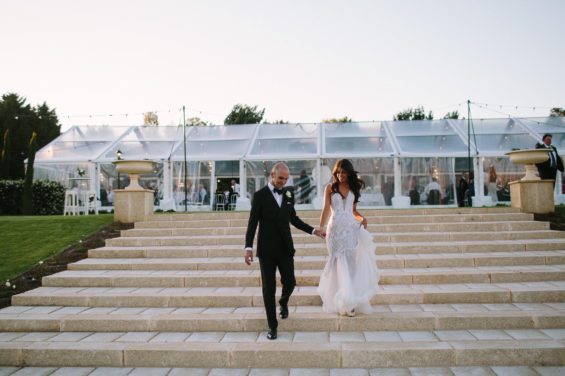Mandalay House Wedding reception in Marquee with Dapper groom in black tie