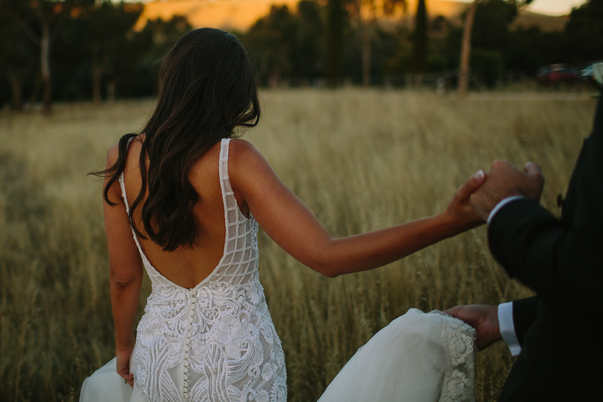 Bridal gown detail in field at dusk in Adelaide Hills
