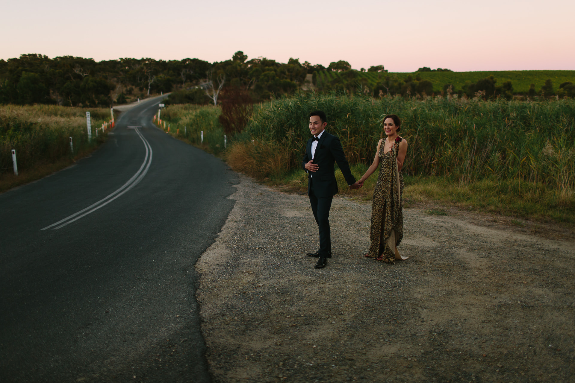 Stylish Bride and groom by the road in currency creek at dusk at One Paddock wedding