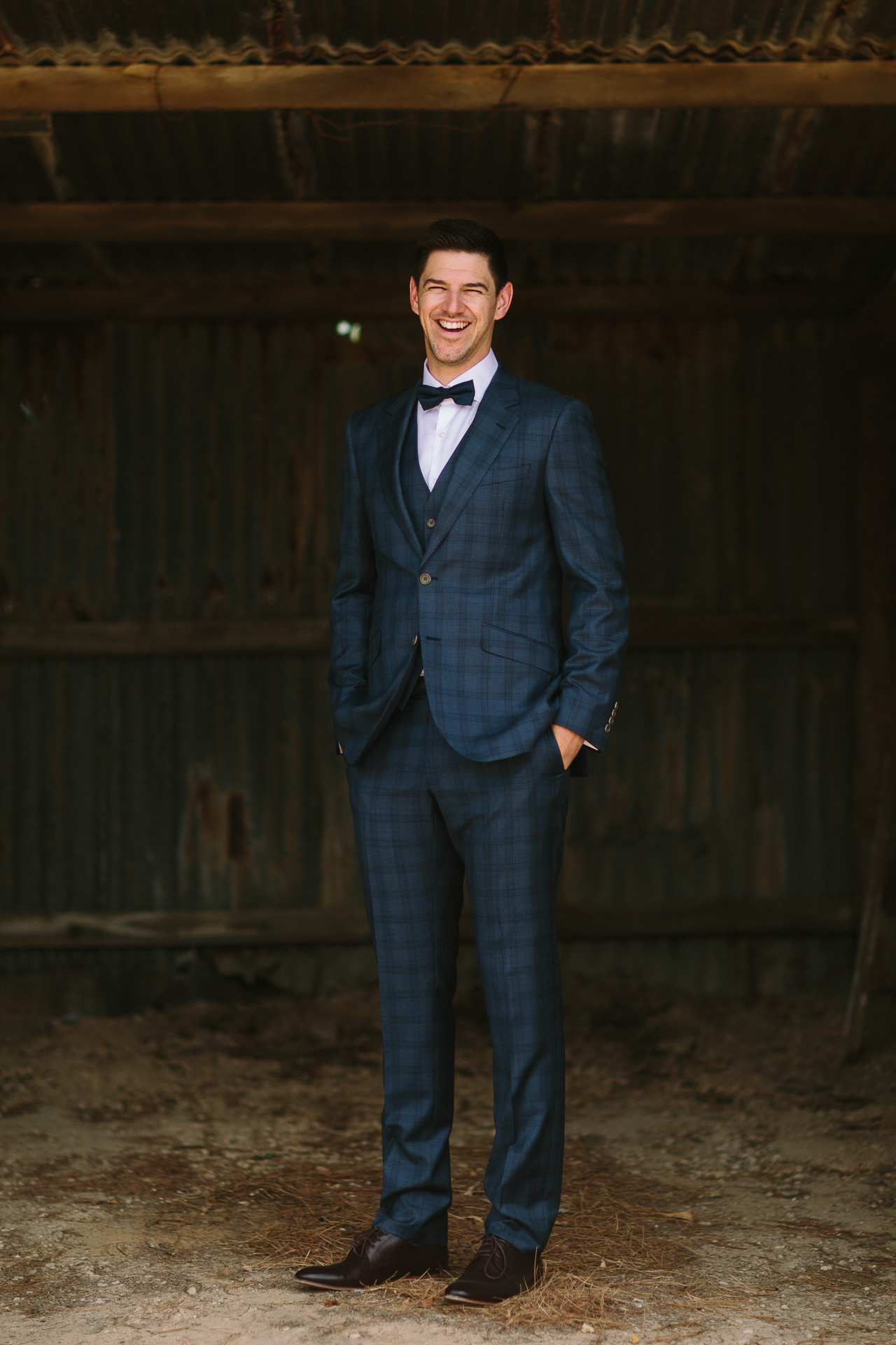 Portrait of Groom in suit before his Winery wedding at Longview vineyard