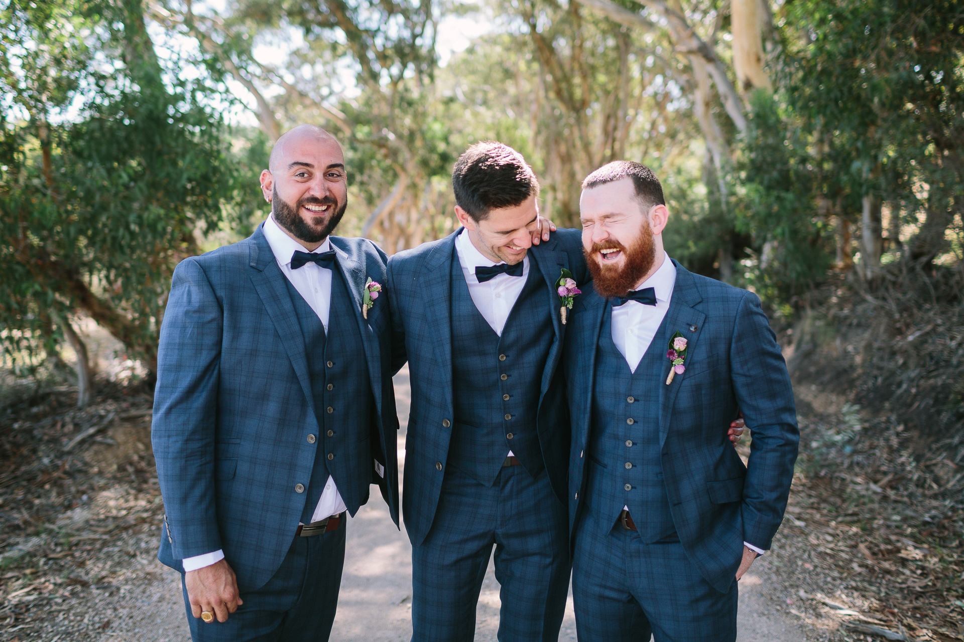 groomsmen laughing longview winery wedding