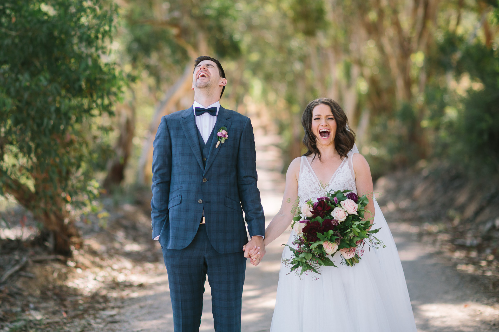 Relaxed bride and groom laugh with joy during wedding photos at Longview winery vineyard
