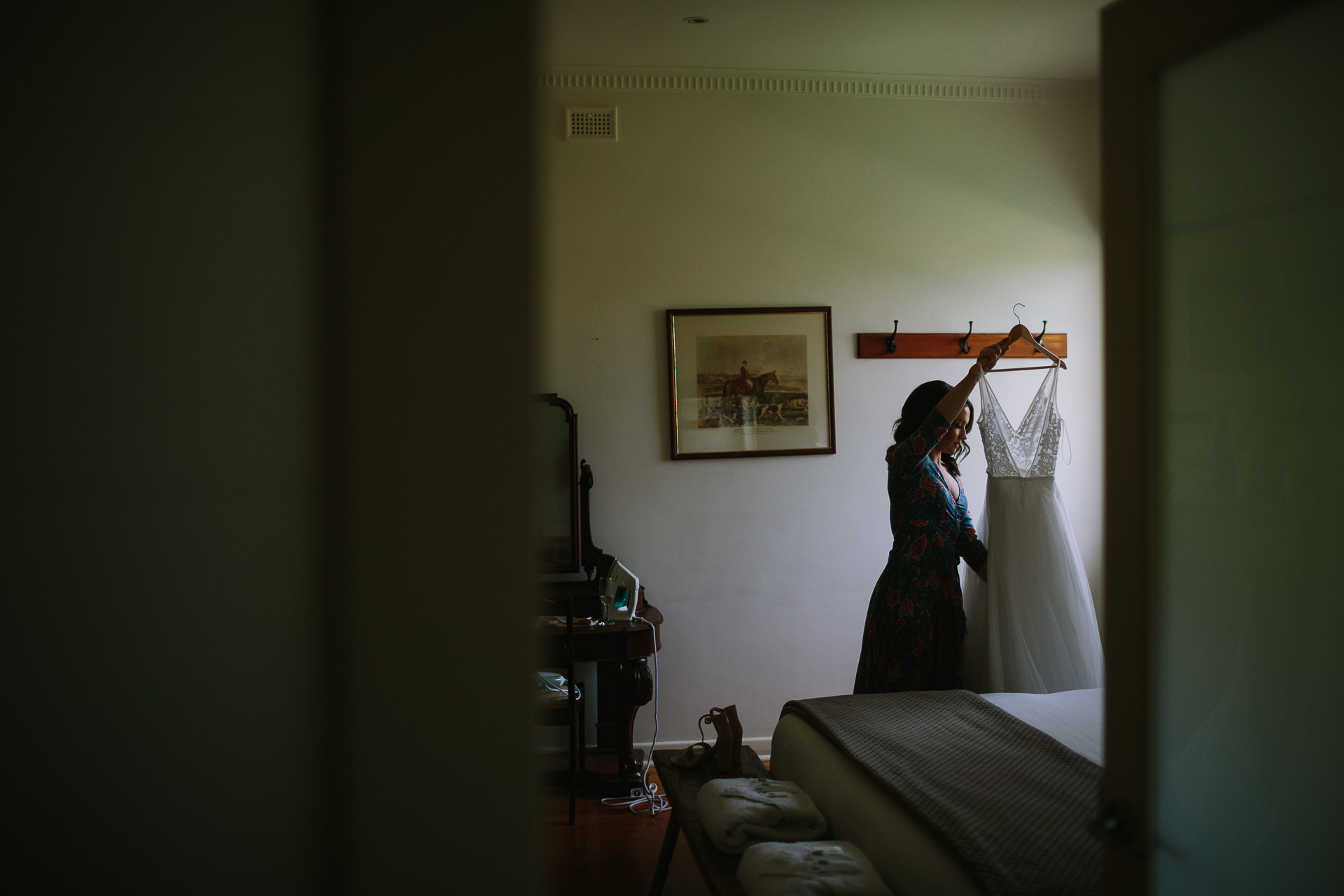 Bride inspects her dress before wedding ceremony in Cottage at Longview vineyard